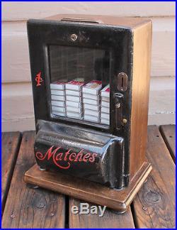 ANTIQUE VINTAGE Cast Iron Matches Higgins Match Box Vendor Penny Vending Machine