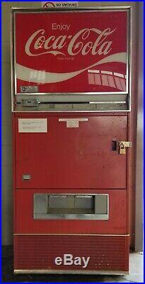 Here is a Vintage Coke vending machine