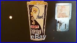 Vintage 1950s heated popcorn vending machine. Works