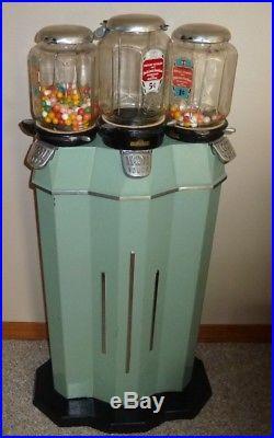 Vintage Unrestored Green Columbus Tri-More 3 Headed Gum Machine. Works Fine