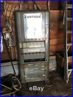 Vintage coin operated candy machine Rowe Canteen