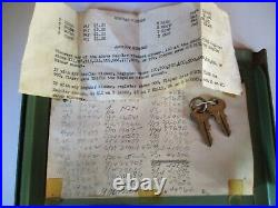 Vintage coin operated grip machine with horoscope, original key